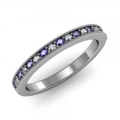 Tanzanite & Diamond Milgrain Ring set in 18K White Gold.