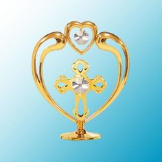 Heart and Cross Figurine With Swarovski Crystal Elements  --  It's simple and simply elegant! The Heart and Cross Figurine is expertly crafted in 24k gleaming gold-plate finish and accented with Swarovski crystal elements that will undoubtedly sparkle against the light. Place on a window sill, on your desk, or that perfect place you are already visualizing. Lovely gift.
