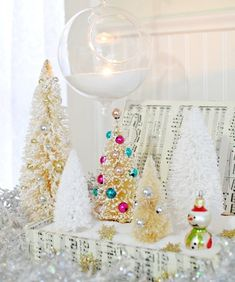 Why spend top dollar for Christmas decor when you can transform a thrift store find into a fun and sparkly holiday scene?