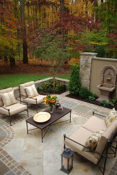 use fountain as focal point in round area w/ seating (like this) out from the bottom of steps; put long ding table where the hot tub was?