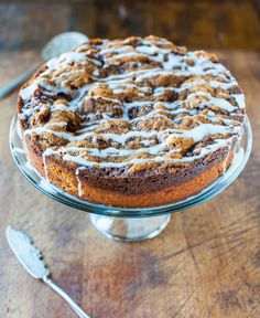 Cinnamon Roll Coffee Cake with Cream Cheese Glaze - The flavor of cinnamon rolls (minus the time or work) baked into an easy cake with a crumbly, buttery, brown sugar topping! Recipe at averiecooks.com