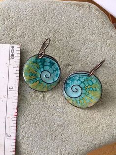 Totally handmade enamel copper earrings with cloisone technique. This beautiful design with blue/green/yellow aqua colors is reminiscent of the seascape. the earrings are torch fired at a very high temperature around 1500F. Enamel is powdered glass fused to a base metal, I used copper. the size of the circle is 13/16 inches. The ear wire is made of niobium metal which is hypoallergenic and very comfortable to wear. Thank you for visiting my shop and please contact me if you hav...