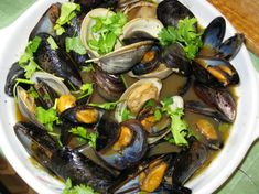 This is the only way my husband wants his mussels prepared; it is a regular around our house. Instead of steaming the mussels in a white wine, garlic sauce - red wine is used. Yum.