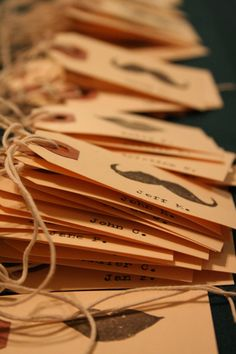diy reception place cards - different stamps... flowers instead of mustaches