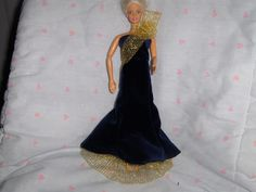 Navy Blue Velour Gown with Gold Net Sash and UnderSkirt fits Barbie and most Fashion dolls http://www.bonanza.com/listings/Navy-Blue-Velour-Gown-with-Gold-Net-Sash-and-UnderSkirt-fits-Barbie-and-most-Fas/42056733