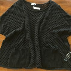 NWT MADEWELL BLACK top. Medium NWT Adorable MADEWELL top in black see through with pockets on front. Not a crop top. Will hit around the top of hips on most. So cute with a bandeau or tank or cami underneath. Great top for spring and summer. Medium Madewell Tops