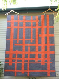 The orange is a shot cotton and in person really adds to the quilt – those shot cottons are so pretty with the depth of color they have.
