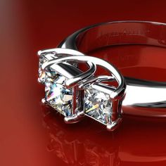 18K White Gold 0.50 Carat Total Weight Three Stone Princess Cut Engagement Ring    This beautiful three stone princess cut engagement ring features two perfectly matched side diamonds of no less than .25 carat each to accompany a princess cut center diamond of your choice.