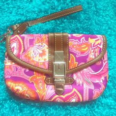 Chaps Paisley Purple/Pink Exotic Large Wristlet Excellent like new condition exotic purple/pink/orange/yellow/white with brown trimming and silver hardware large Wristlet with four areas for storage. Fun and beautiful bright piece. No flaws at all. Chaps Bags Clutches & Wristlets
