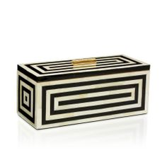 The Baily box by Tory Burch is a timelessly chic, graphic accessory ideal for storing treasured mementos and small trinkets.