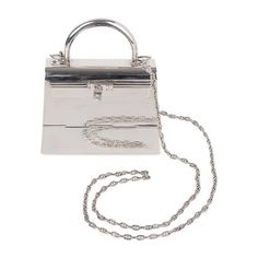 One of the most rare Hermes bags ever produced is the exquisite Sterling Silver Hermes. Emo Fashion, 1930s Fashion, Fashion Vintage, Victorian Fashion, Stella Maccartney, Silver Bags, Vintage Purses, Vintage Hats, Mad Hatter Hats