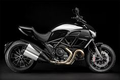 DUCATI DIAVEL CROMO MOTORCYCLE  Most of the new motorcycles we've seen recently have been moving away from flashy chrome. The Ducati Diavel Cromo Motorcycle ($TBA) embraces it, with a chrome mirror-finished gas tank that contrasts with other gloss black parts.