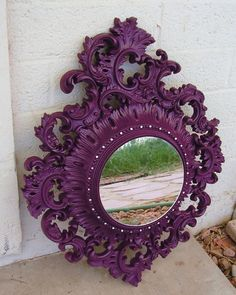 Rococo splendor reimagined with a bold pop of dramatic purple color. So theatrical. A very Hollywood Regency thing to do.