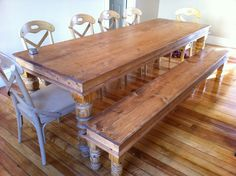 Handcrafted Solid Pine Natural Finish Dining Table Hand Carved Legs With Matching Bench. $1,049.00, via Etsy.