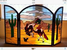Ride'em Cowboy - This is a fire place screen that is my own design.