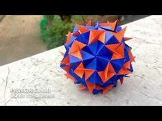 Use 30 rectangle sheets of origami paper. Difficulty : ⭐⭐⭐ Time: 2 hours Triangle claw appendage of the ball. True Wallet, Origami Diagrams, Diwali Craft, Origami Paper, Paper Size, Blue Orange, Paper Crafts, Make It Yourself, Youtube