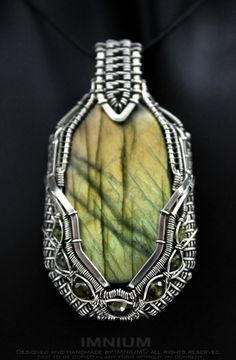 Green wire wrapped pendant  with labradorite, tourmaline and pyrite by IMNIUM on Etsy