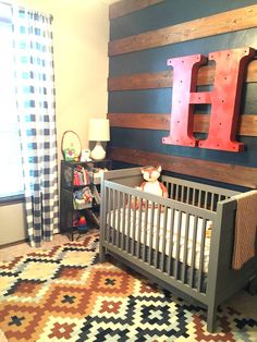 Rustic, Industrial Baby Boy Nursery - we love the mix of buffalo check drapes paired with the kilim rug!