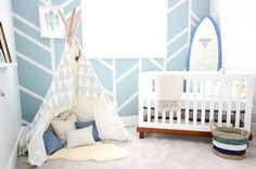 Bright kids room with a toddler bed and comfortable DIY teepee bed nook.