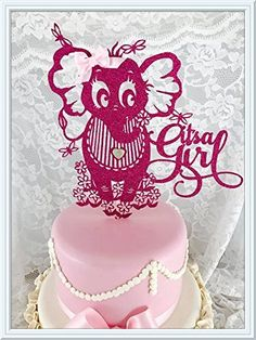 It's A Girl Cake Topper. It's a girl, congrats! A It's a Girl party is the best way to celebrate her arrival with this beautiful It's A Girl cake topper. We've taken the concept of a It's A Girl Baby Shower party and elevated it with high quality glitter card stock. This It's A Girl decoration is further distinguished with the use of real ribbon for the bow in her hair, heart bling on her belly and craft flat pearls decorating the middle of the flowers at the bottom. Making it a...
