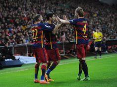 Luis Suarez of FC Barcelona celebrates with Ivan Rakitic and Aleix Vidal after scoring his team's 3rd goal during the La Liga match between Sporting Gijon and FC Barcelona at Estadio El Molinon on February 17, 2016 in Gijon