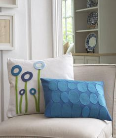 Pillows.  http://www.womansday.com/Articles/Home/Crafts/Craft-Project-Personalize-Throw-Pillows.html