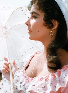 "Elizabeth Taylor, ""Raintree County"" 1957 playing Susanna Drake. Laurel Award for Top Female Dramatic Performance. Nominated - Academy Award for Best Actress."