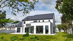 This contemporary new family home in South Mayo is a Project recently completed by Simon Beale + Associates. We led the clients from the initial design and planning consultation, to on site supervi… House Designs Ireland, Cool House Designs, Family House Plans, Home And Family, Old School House, House Extensions, Interior Design Services, New Builds, Building A House
