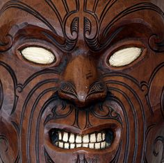 Detail of mask depicting Maori facial tattoos, from the Museum of Art and History in Rotorua, NZ. Photo by anoldent.