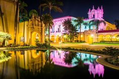 The El Prado Restaurant and Lily Pond at night in Balboa Park, San Diego, California.