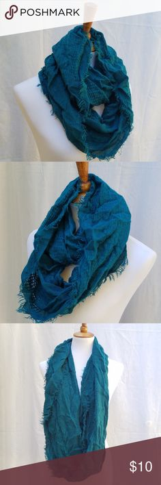 Teal infinity scarf with frayed edges Teal infinity scarf with frayed edges, cute lightweight scarf perfect for the cooler temps or even Spring time! No brand but it was bought at Maurices, like new condition. Maurices Accessories Scarves & Wraps
