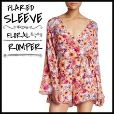 """Floral Romper-LAST CHANCE‼️ Bell sleeves and a wrap front give this modern print romper some throwback edge. - Surplice neck - Back zip closure - Long sleeves - Side tie detail - Banded waist - Allover print - Lined - Approx. 33"""" length, 3"""" inseam - Made in USA Fiber Content: Shell: 100% rayon Lining: 100% polyester Boutique Pants Jumpsuits & Rompers"""
