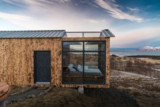 This Tiny Glass Cabin Lets You Sleep Under the Northern Lights - Photo 1 of 7 - The cabin is located in Hvalfjörður, Iceland, just a 30-minute drive from Reykjavík, and can only be accessed by car. The area is remote, private, and quiet, making it ideal for viewing the Northern Lights at night, as well as hiking during the day.