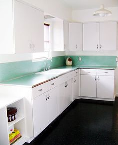 All White Metal Cabinets Ahhhhhhh With A Little Nod To The Vintage Teal