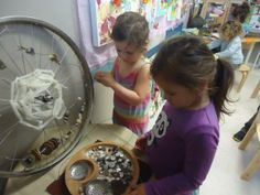 """A spider web using recycled materials... an old bicycle wheel, wire, buttons, sticks etc from Nature's Play Preschool -Pegasus ("""",)"""