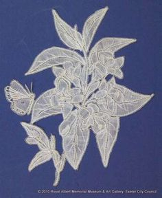This rhododendron sprig is one of a series of naturalistic sprigs (lace motifs) said to have been designed and made by Louisa Tucker, a daughter of the Branscombe lace manufacturer John Tucker. These finely made pieces are naturalistic representations of wild and garden plants found in East Devon. They were made on a lace pillow using bobbins wound with fine cotton threads. This motif represents a flowerhead surrounded by leaves, and a butterfly. Needle Lace, Bobbin Lace, John Tucker, The Royal Collection, Lace Weddings, Royal Albert, Butterfly Wings, Cotton Thread, Three Dimensional