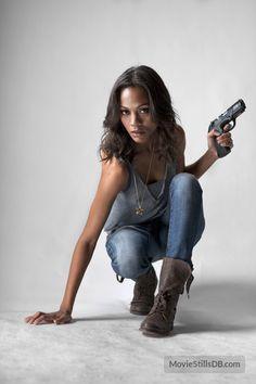 "danhacker: "" Zoe Saldana 'Colombiana' Promotional Photoshoot Any movie where Zoe Saldana plays one badass lady is a movie I'll pay good money to see."