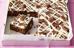 Chewy chocolate oat squares are a cross between a cake and a flapjack and so easy to make. The kids will love making these with you. Ready in under 1hr, this simple tray bake is made with cocoa powder to give it a rich, chocolatey flavour, drizzled with melted white chocolate and packed with rolled oats. These squares are a cross between a cake and a flapjack. Store in an airtight container for up to 2 days.