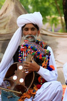 The old baloch singer, a man in tradition clothes from Balochistan, by Engineer J