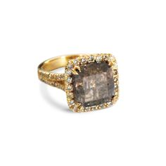 Cushion-shaped highly included diamond ring, with a cut-down diamond cluster…