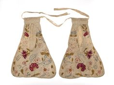 A pair of pockets joined with linen tape. The fronts of the pockets are made of white cotton embroidered in coloured wools with satin. The stem and chain are stitched in a floral pattern. The backs of the pockets are made of linen. The fabric is turned up inside the pocket to form a double bag.     Date  1740 AD - 1760 AD
