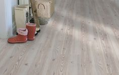 Pergo Silver Pine laminate plank flooring (remember to get the Living Expression one with 4-way bevel)