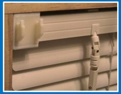 Slide on brackets that allow you to hang curtains across blinds without drilling holes! Great idea for rentals!