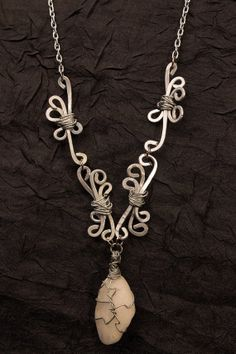A gallery piece of mine! Silver and Beach Stone Wire Wrapped Necklace by Eldwenne on Etsy, $48.00