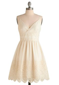 triangle surplice bodice, adjustable straps, and an overlay of cream chiffon embroidered with dainty diamonds at the waist, and boasting beautiful, frosting-like lacework at the scalloped hem, this tasty treat is just what you need to transition your summer wardrobe