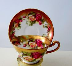 """Here is a Royal Chelsea """"Golden Rose"""" English bone china teacup and a saucer set. 