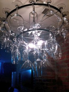 Wine Glass Chandelier http://www.planitdiy.com/inspiration/in-decor/wine-glass-chandelier-no-one-will-ever-ask-where-the-wine-glasses-are-again/#