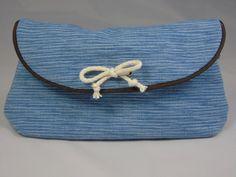 http://de.dawanda.com/product/96039495-kosmetiktasche-hellblau-canvas-paspel-clutch