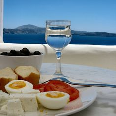mediterranean meal time - i would love to eat this with that view!