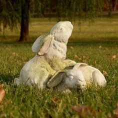 Two rabbits at play statue. A lovely depiction of two long eared bunny rabbits playing together in the grass. This would be a beautiful piece for your front yard or garden area. This piece reminds us of the joys of springtime as the rabbits come out to play. This piece is made of heavy cast fiberglass and is designed to take the outside weather year round. Several finish options available for these rabbits.